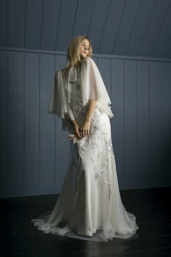 Soft layered bridal cape and embroidered full length dress by Halfpenny London