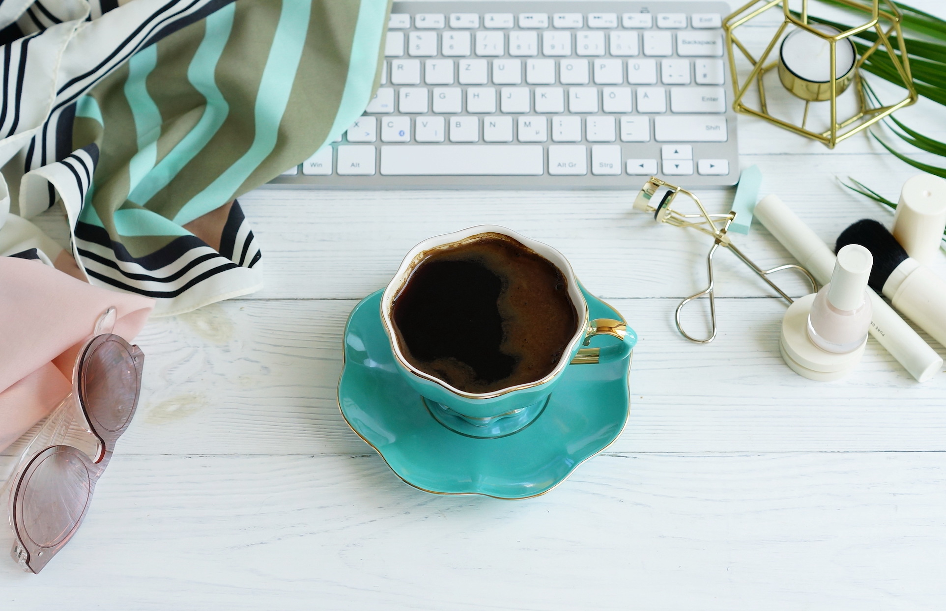 Cup of coffee and laptop for shopping online