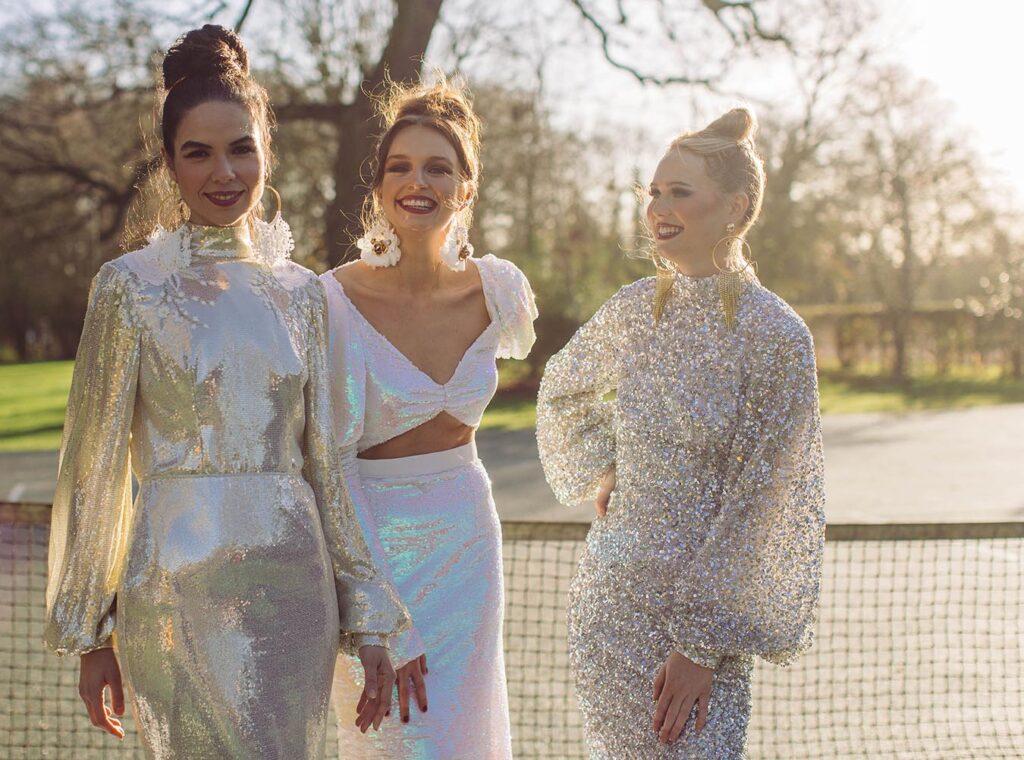 three brides in sparkly wedding dresses